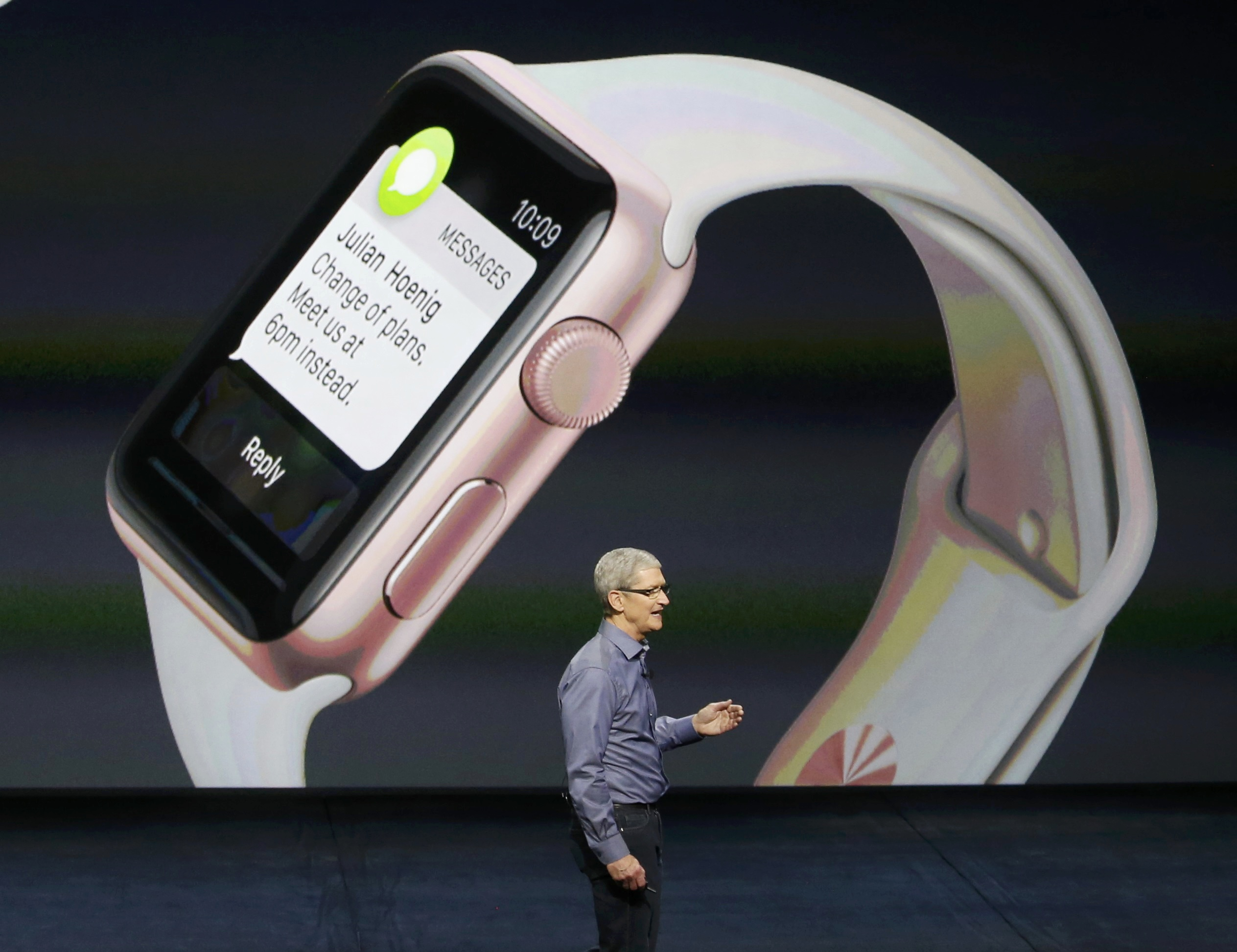 Apple CEO Tim Cook closes the presentation as an Apple Watch is shown in background during an Apple media event in San Francisco, California, September 9, 2015. Reuters/Beck Diefenbach